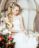 Beauty young blond woman bride alone in luxury vintage interior with a lot of flowers. Close up Stock Images