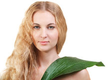 Beauty young blond woman with green leaf isolated on white Royalty Free Stock Photo
