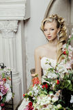 Beauty young bride alone in luxury vintage interior with a lot of flowers close up Royalty Free Stock Images