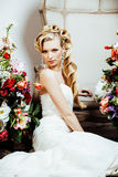 Beauty young bride alone in luxury vintage interior with a lot of flowers close up Stock Image