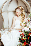 Beauty young bride alone in luxury vintage interior with a lot of flowers close up Royalty Free Stock Photos