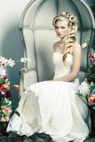 Beauty young bride alone in luxury vintage interior with a lot of flowers, makeup and creative hairstyle. Closeup stock photos