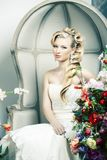 Beauty young bride alone in luxury vintage interior with a lot of flowers, makeup and creative hairstyle. Closeup royalty free stock photo