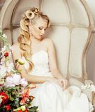 Beauty young bride alone in luxury vintage interior with a lot o Stock Images