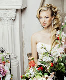Beauty young bride alone in luxury vintage interior with a lot o. F flowers close up, wedding style Stock Photo