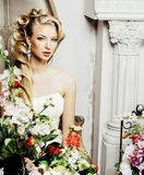 Beauty young bride alone in luxury vintage interior with a lot o Stock Photography