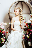 Beauty young bride alone in luxury vintage interior with a lot o Stock Image