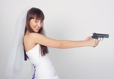 Beauty young bride  holding the gun Stock Image