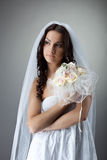 Beauty young bride portrait with bunch of flowers Royalty Free Stock Photography