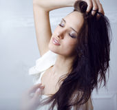Beauty young brunette sad woman close up,real spa Royalty Free Stock Photo