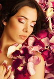 Beauty young brunette woman with flower close up Royalty Free Stock Photography
