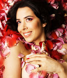 Beauty young brunette woman with flower close up, rose petails spa Stock Images