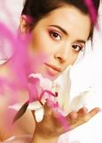 Beauty young brunette woman with flower close up Stock Photos