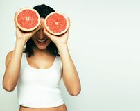 Beauty young brunette woman with grapefruit isolated on white ba Royalty Free Stock Images