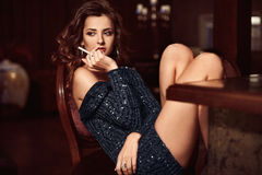 Beauty young brunette woman sitting at the bar Stock Image