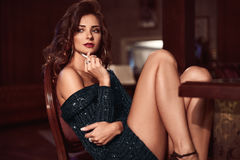 Beauty young brunette woman sitting at the bar Royalty Free Stock Photography