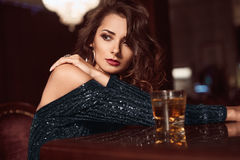 Beauty young brunette woman sitting at the bar Royalty Free Stock Image