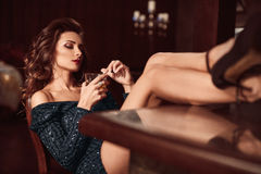 Beauty young brunette woman sitting at the bar Stock Photos