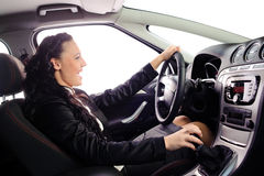 Beauty young businesswoman drive the car. You can set any background in place of white windows Royalty Free Stock Image