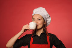 Beauty young cook with coffee Royalty Free Stock Photography