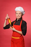 Beauty young cook hold bottle Royalty Free Stock Images