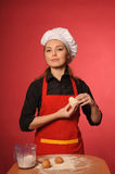 Beauty young cook Stock Images