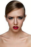 Beauty young female Model with smoky Eyes with negative emotions Stock Image