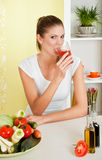 Beauty, young girl drinking tomato juice Royalty Free Stock Images