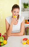 Beauty, young girl eating acid lemon Royalty Free Stock Photography