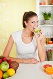 Beauty, young girl eating apple Stock Photography