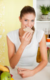 Beauty, young girl eating biscuit Royalty Free Stock Image