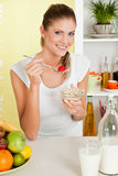 Beauty, young girl eating cereal and fruit Stock Photos