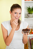 Beauty, young girl eating raisin Royalty Free Stock Images