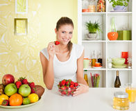 Beauty, young girl eating strawberry Stock Photo