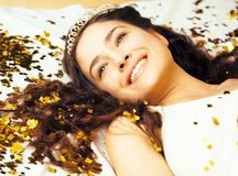 Beauty young girl in gold confetti and tiara, Royalty Free Stock Photos