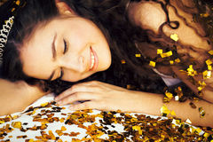 Beauty young girl in gold confetti and tiara. Little princess celebration close up Royalty Free Stock Photos