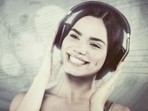 Beauty young girl hearing music with headset Stock Photography