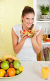 Beauty, young girl holding fruit-salad Stock Image