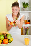 Beauty, young girl holding fruit salad Royalty Free Stock Photos