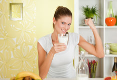 Beauty, young girl holding a glass of milk Royalty Free Stock Photos