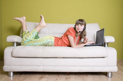 Beauty young girl with laptop Royalty Free Stock Photography