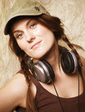 Beauty young girl listening music in headphones Royalty Free Stock Image