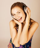 Beauty young girl listening music in headphones Stock Photos