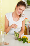 Beauty, young girl making lemon water. Beauty, happy, young girl making lemon water Royalty Free Stock Photography