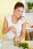 Beauty, young girl making lemonade. With lemon grass Stock Image