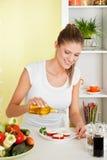 Beauty, young girl making mozarella salad Stock Photo
