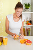 Beauty, young girl making orange juice Royalty Free Stock Photos