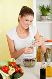 Beauty, young girl making salad Royalty Free Stock Photo