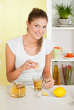 Beauty, young girl making tea. With honey Stock Images