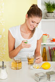 Beauty, young girl making tea. With honey Stock Photo